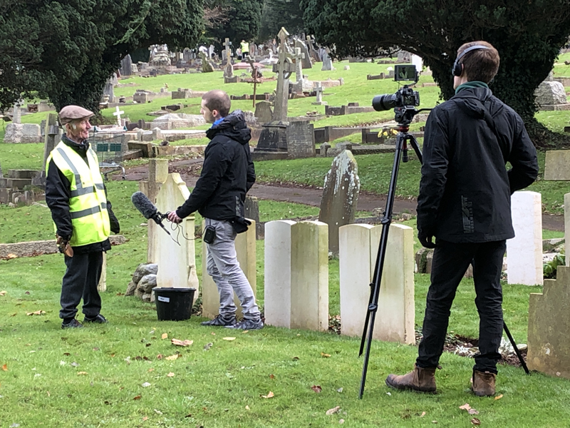 Vane Hill resident being interviewed about volunteering to clean war graves as part of a new 'Eyes On, Hands-On' project run by The CWGC
