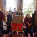 Campania ARBD residents holding up their hand painted Armistice Day tribute