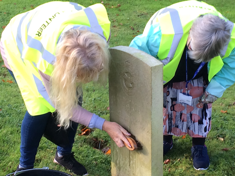 Vane Hill ARBD care home residents cleaning war graves as part of a new 'Eyes On, Hands-On' project run by The CWGC