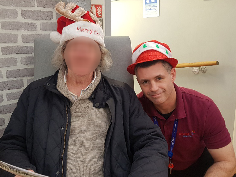 Campania ARBD care home staff and resident wearing Festive hats