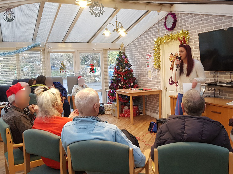 Campania ARBD care home residents enjoying their Christmas mini concert