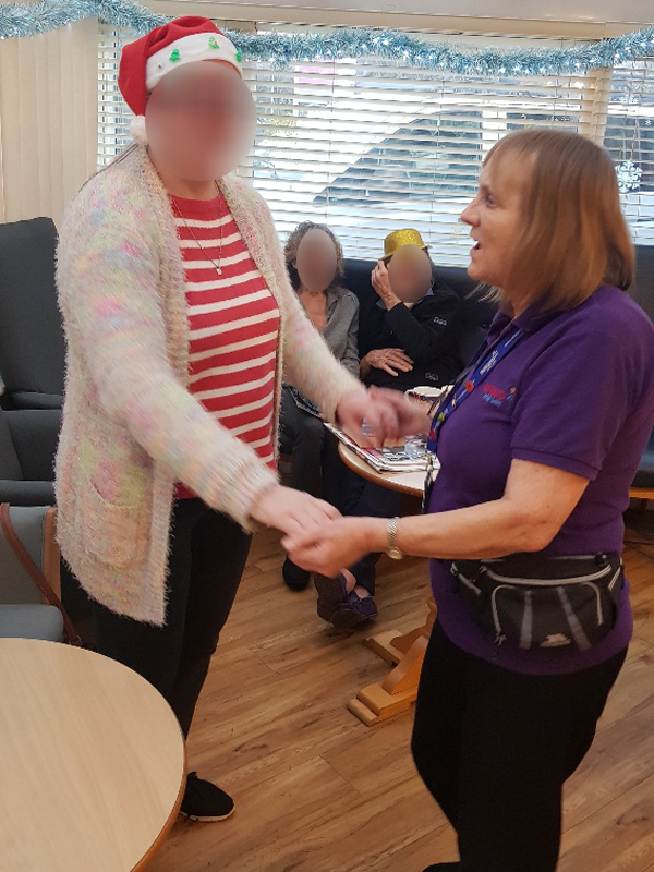 Campania ARBD care home staff and resident dancing