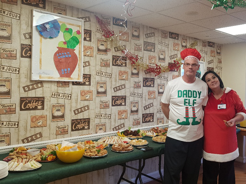 Campania ARBD care home chefs in front of their Christmas buffet