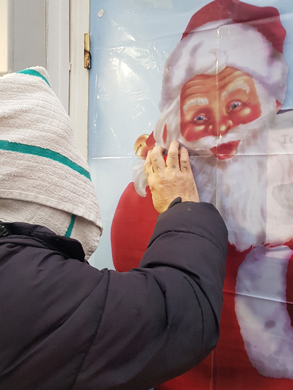 Campania ARBD care Home resident playing 'pin the nose on Santa'