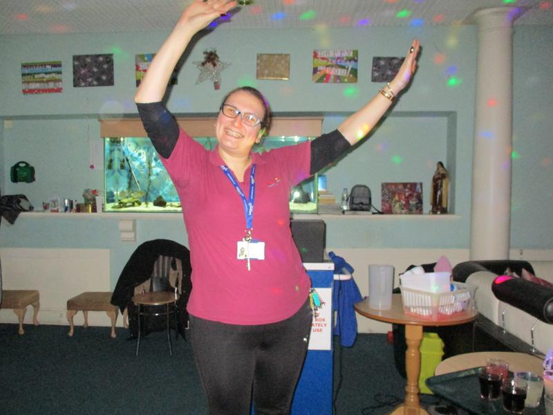 Serenita ARBD Care home staff member dancing at Christmas party