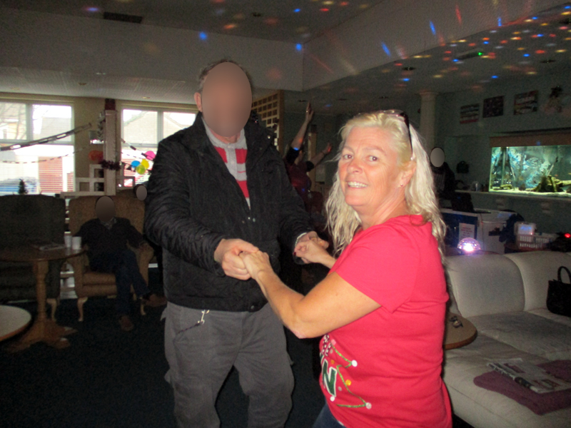 Serenita ARBD Care home staff and resident dancing at Christmas party