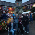 Serenita ARBD care home residents and staff outside the Gingerbread Inn, Priddy