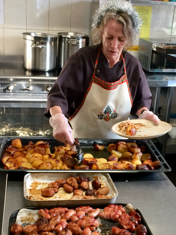 Vane Hill ARBD care home resident dishing out the Christmas Day Lunch