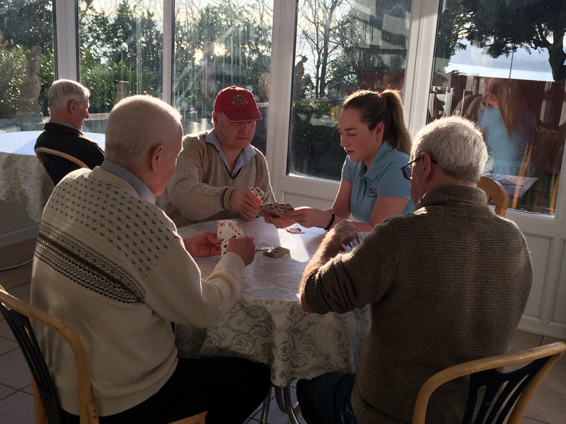 Cavan institute, Ireland, Nursing student playing cards with the residents at Vane Hill ARBD care home