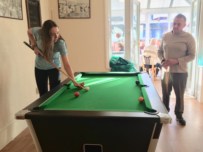 Cavan institute, Ireland, Nursing student playing pool with the resident at Vane Hill ARBD care home